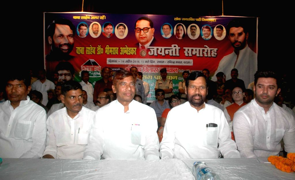 LJP chief and Union Minister for Consumer Affairs, Food and Public Distribution Ramvilas Paswan and Chirag Paswan during a programme organised on Ambedkar Jayanti in Patna on April 14, 2016.