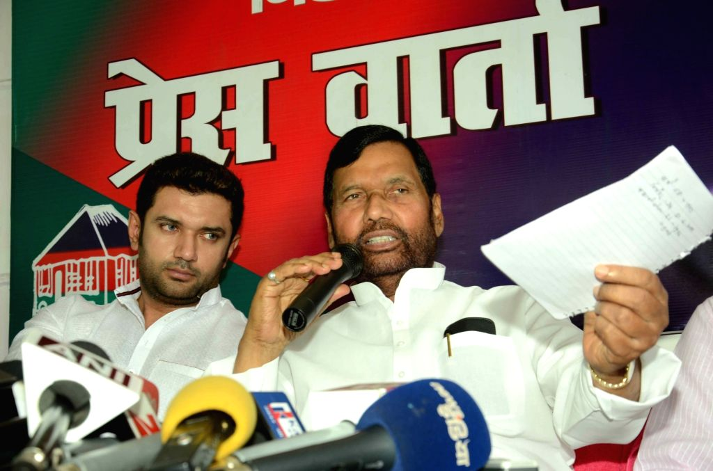 LJP chief and Union Minister for Consumer Affairs, Food and Public Distribution Ramvilas Paswan addresses a press conference in Patna, on July 24, 2016. Also seen LJP MP Chirag Paswan.