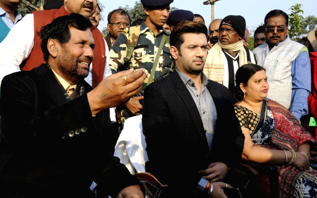 LJP chief and Union Minister for Consumer Affairs, Food and Public Distribution Ramvilas Paswan and Chirag Pasawan address a press conference in Patna on Jan 14, 2017.