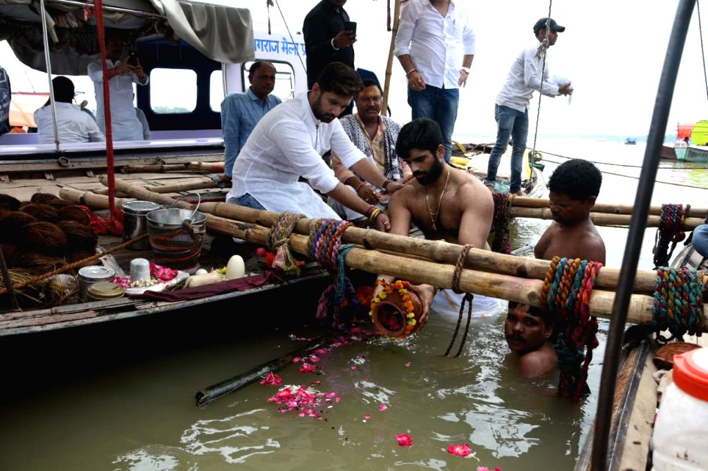 LJP leader Late Ram Chandra Paswan's son Prince Raj accompanied by brother Chirag Paswan, immerses the ashes of his father at Sangam in Prayagraj on July 27, 2019.