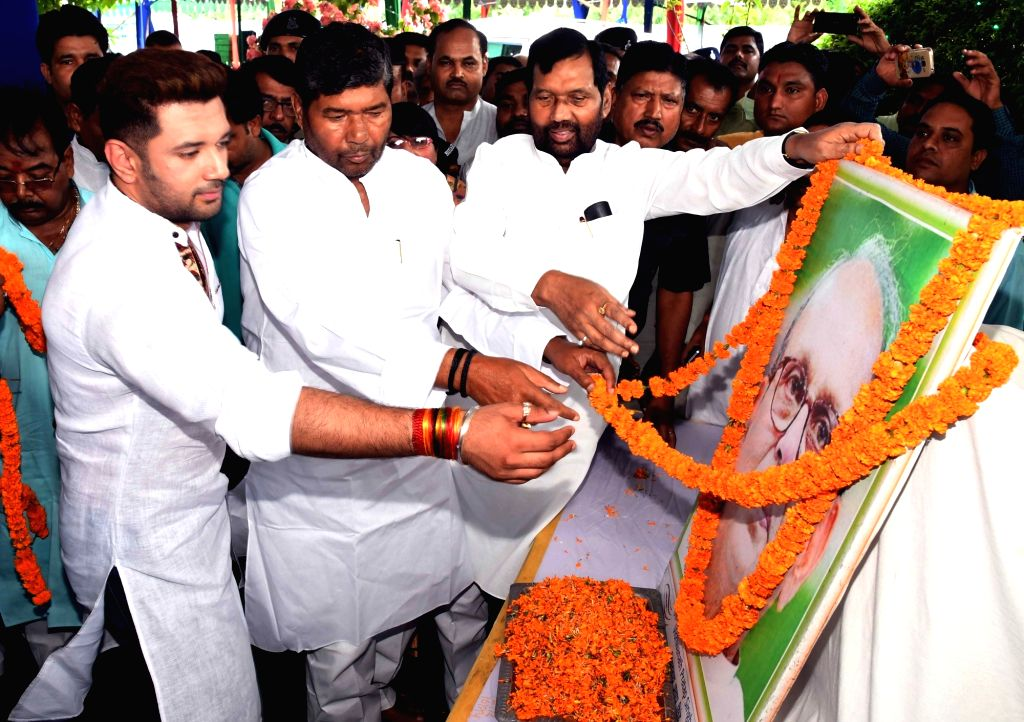 LJP leaders Ramvilas Paswan and Chirag Paswan pay tribute to former prime minister VP Singh on his birth anniversary in Patna on June 25, 2017. - V