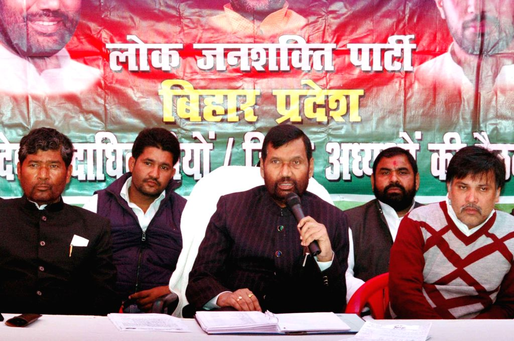 LJP supremo Ramvilas Paswan addresses during a press conference in Patna on Dec.13, 2013.
