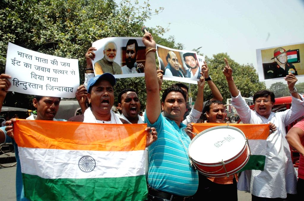 LJP workers celebrate Indian Army's 'punitive assault' on Pakistan posts, in Patna on May 24, 2017.