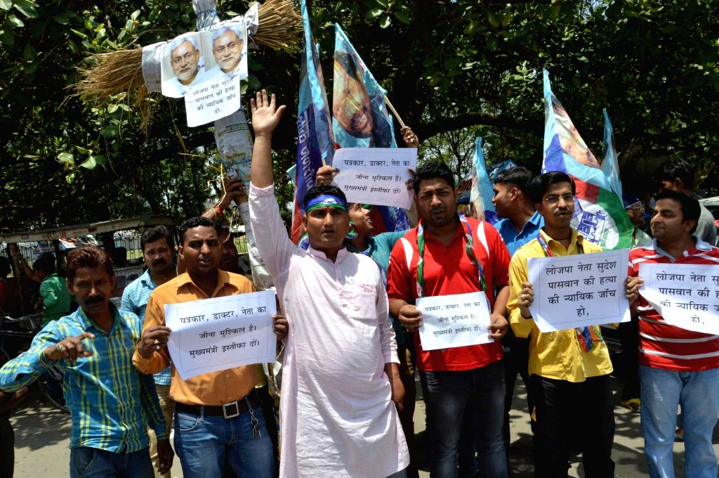 LJP workers stage a demonstration against murder of LJP leaders Sudesh Paswan and his brother Sunil Paswan by Maoists in broad daylight near Tola Dubat in Gaya; on May 26, 2016.