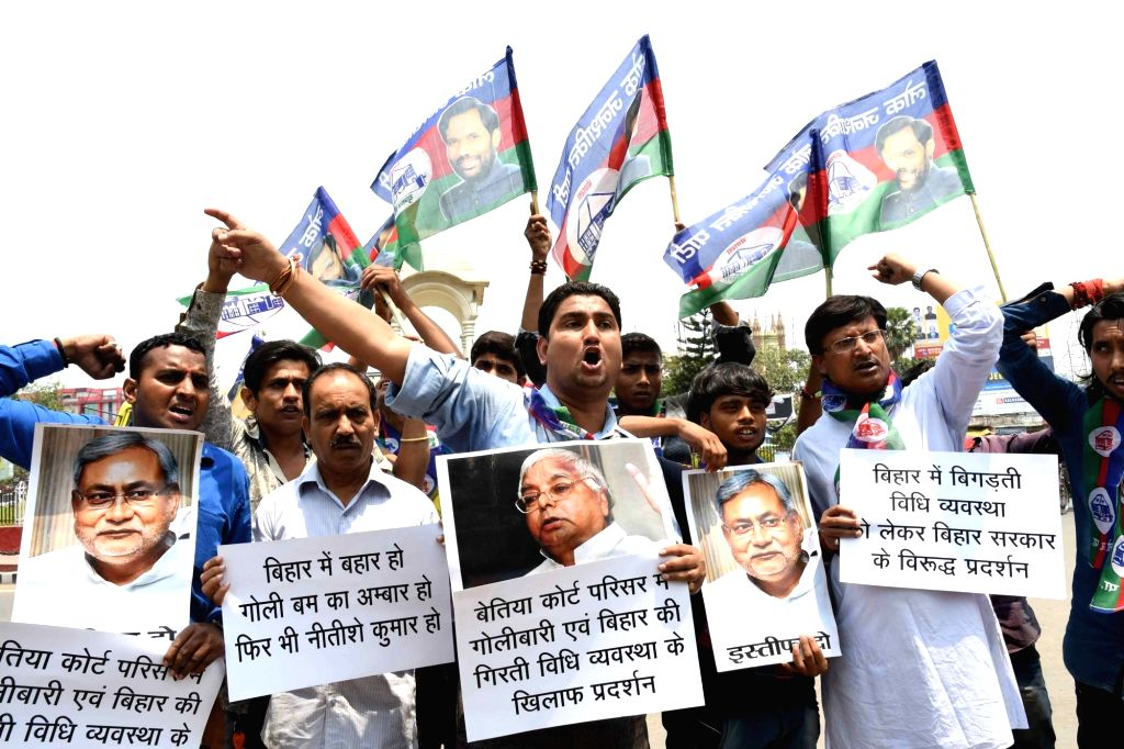 LJP workers stage a demonstration against rising crime in Bihar,  in Patna on May 12, 2017.