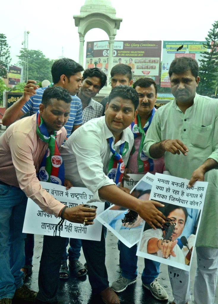 LJP workers stage a demonstration against West Bengal Chief Minister Mamata Banerjee over recent communal violence at Baduria; in Patna, on July 7, 2017. - Mamata Banerjee