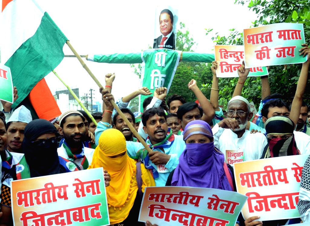 """LJP workers stage a demonstration as Pakistan observe """"Black Day"""" over violence in Kashmir on July 19; in Patan on July 19, 2016."""