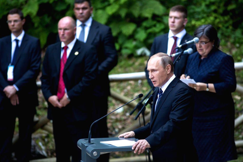LJUBLJANA, July 31, 2016 - Russian President Vladimir Putin (front) speaks at the 100th anniversary of the Russian Chapel in Kranjska Gora, Slovenia, July 30, 2016. Russian President Vladimir Putin ...
