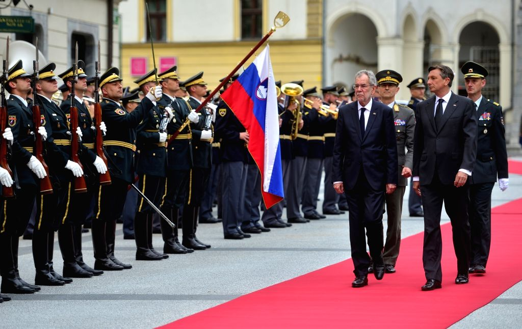LJUBLJANA, May 24, 2017 - Slovenian President Borut Pahor (Front R) and visiting Austrian President Alexander Van der Bellen (Front L) inspect the honor guard during a welcome ceremony in Ljubljana, ...
