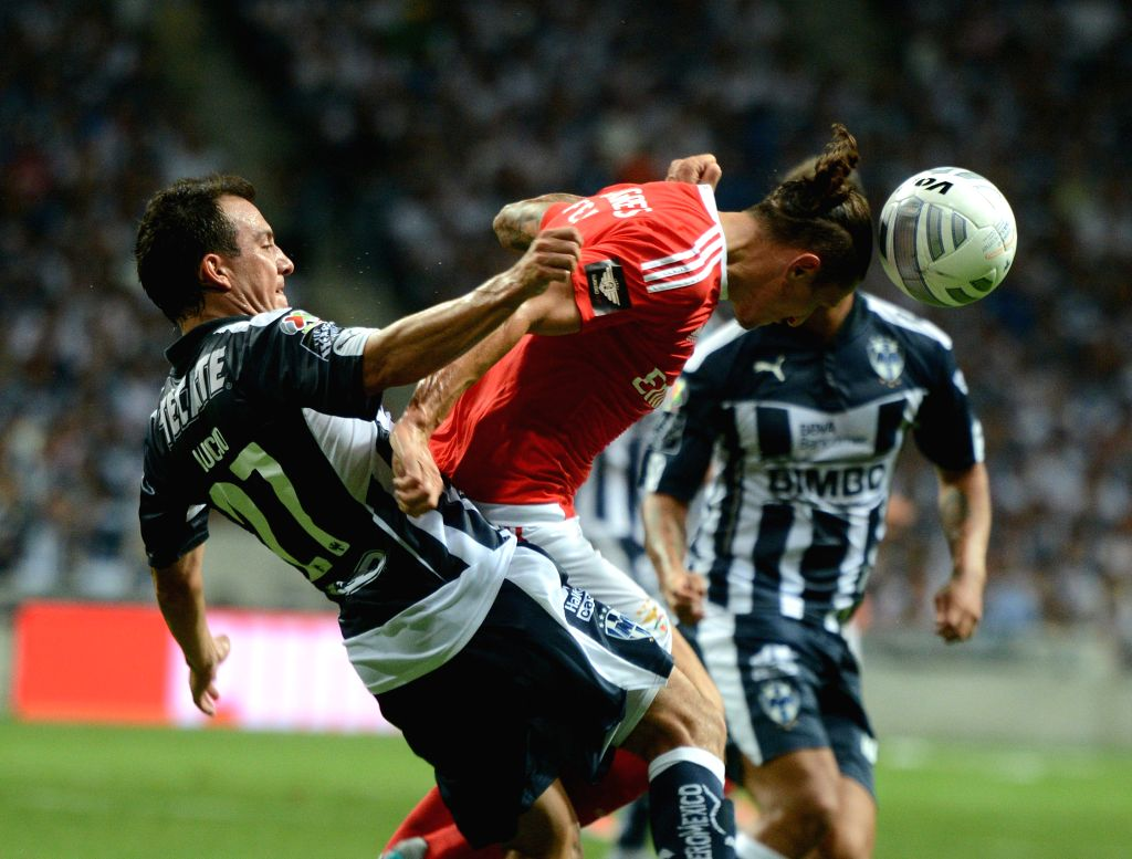 Ljubomir Fejsa (C) of Portugal's Benfica competes in the friendly match against Monterrey at the BBVA Bancomer Stadium in Guadalupe Municipality, Mexico, on Aug. ...