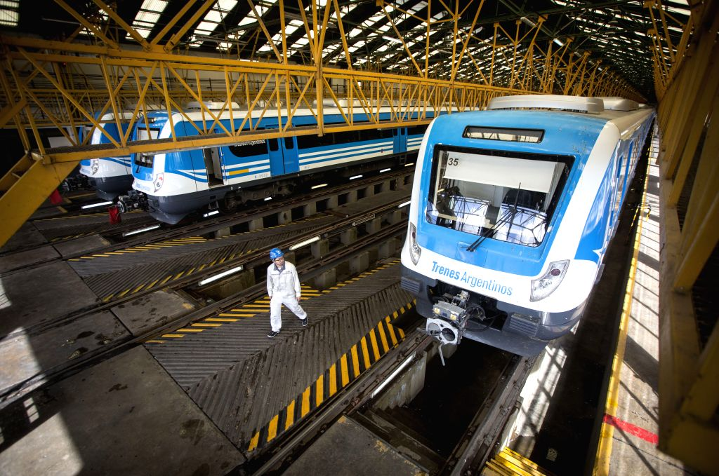 LLAVALLOL, April 18, 2017 - Photo taken on April 11, 2017 shows a technician from China's CRRC Sifang Locomotive and Rolling Stock Co., Ltd. walking on a platform where trains are parked for review ...