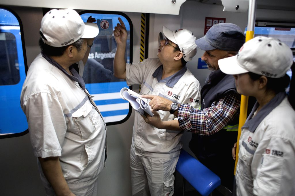 LLAVALLOL, April 18, 2017 - Photo taken on April 11, 2017 shows engineers from China and Argentina working on a train parked for review at the workshops of the Roca Line, in Llavallol, Argentina. ...