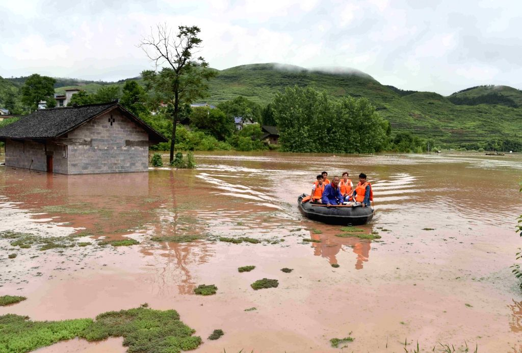 Local residents are evacuated in Songtao Miao Autonomous County of Tongren City, southwest China's Guizhou Province, June 23, 2017. Flash floods broke out here due to continuous heavy ...