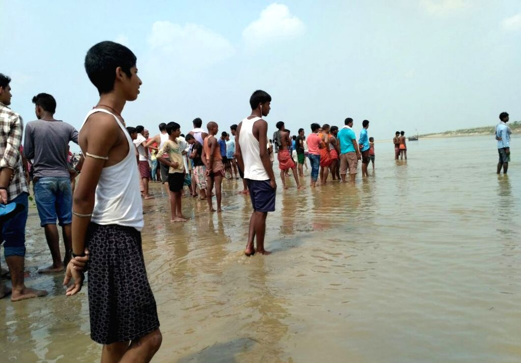 Locals gather at the banks of Ganga river after 6 youths drowned while taking a bath in Maner, Bihar on Sept 27, 2017.