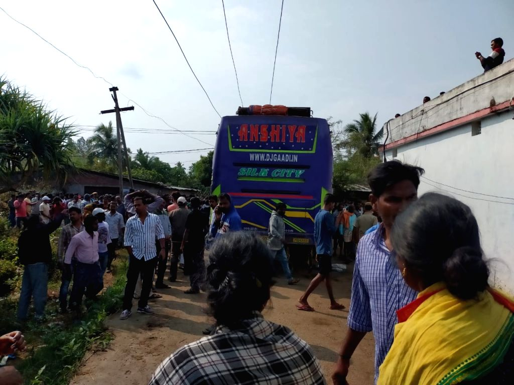 Locals gather at the site where a bus came in contact with an 11 KV power transmission line, electrocuting five passengers to death and injuring over 30, in Odisha's Ganjam district on Feb 9, ...