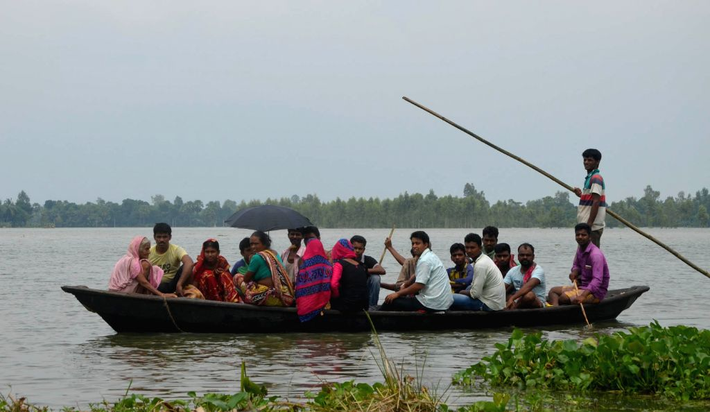Locals rescue flood victims using boats in the Malda district of West Bengal on Aug 18, 2017.