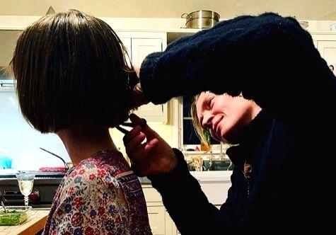Lockdown diaries: Uma Thurman helps daughter cut her hair.