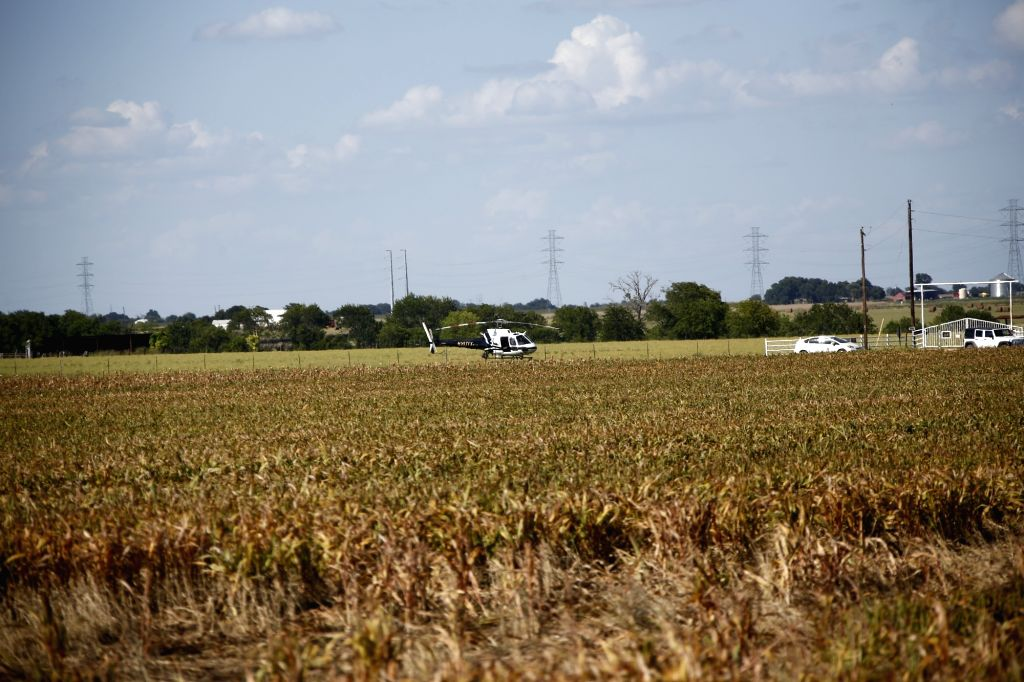 LOCKHART, July 31, 2016 - A helicopter is seen at the site of a balloon crash accident near Lockhart, a city in the central part of the U.S. state of Texas, July 30, 2016. U.S. Texas Department of ...