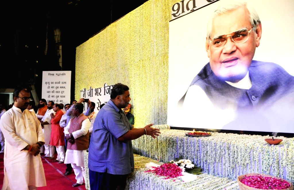 Lok Janshakti Party chief Pappu Yadav pays tributes to former Prime Minister Late Atal Bihari Vajpayee during a prayer meeting organised in his memory, in Patna on Aug 21, 2018. - Late Atal Bihari Vajpayee and Pappu Yadav