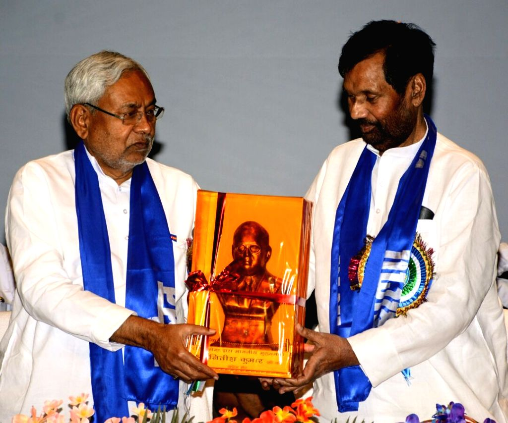 Lok Janshakti Party (LJP) President Ram Vilas Paswan felicitates Bihar Chief Minister Nitish Kumar during a programme organised by the party on Dr. B.R. Ambedkar's 127th birth anniversary, in Patna ... - Nitish Kumar
