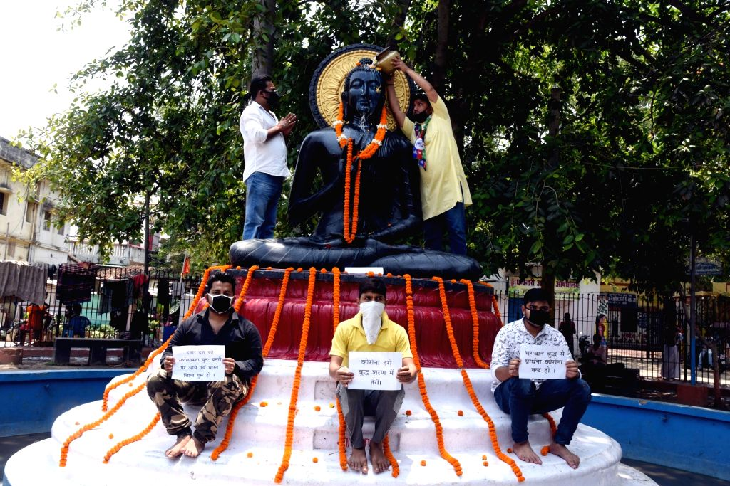 Lok Janshakti Party (LJP) workers garland the statue of Lord Buddha on the occasion of Buddha Purnima in Patna during the extended nationwide lockdown imposed to mitigate the spread of ...