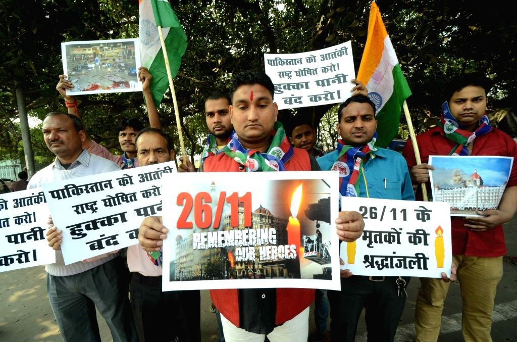 Lok Janshakti Party (LJP) workers pay tribute to the victims of 26/11 Mumbai terror attacks on its 8th anniversary in Patna on Nov 26, 2016.