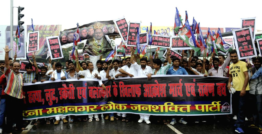 Lok Janshakti Party (LJP) workers stage a demonstration against the Bihar Chief Minister Nitish Kumar in Patna, on Aug 8, 2015. - Nitish Kumar