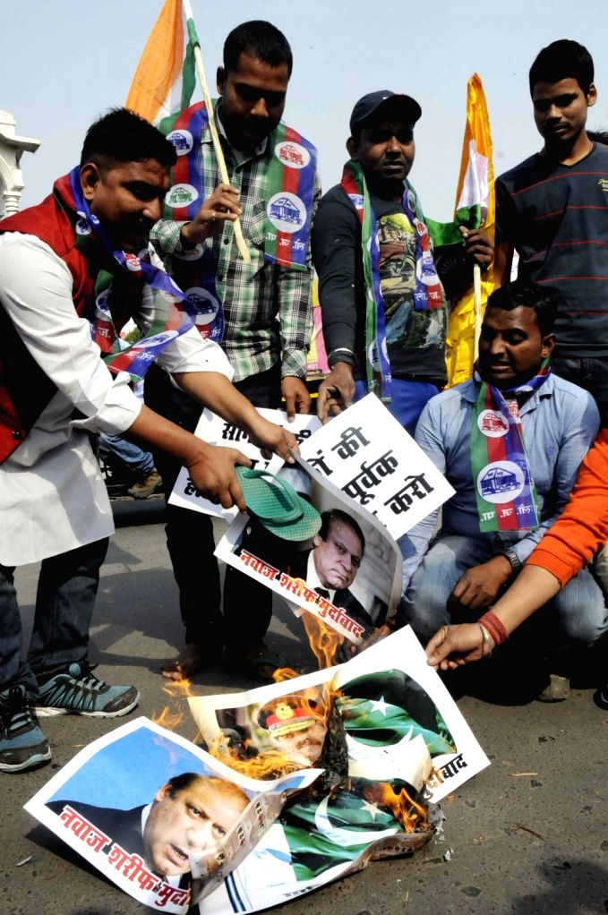 Lok Janshakti Party (LJP) workers stage a demonstration against unprovoked ceasefire violations by Pakistan along the LoC in Patna on Nov. 23, 2016.