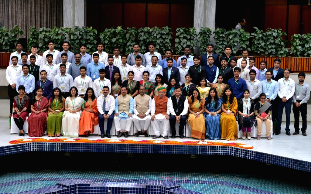 Lok Sabha Speaker Om Birla and Union Minister Arjun Ram Meghwal pose for a group photo with 2017 batch IAS Officers at Parliament Annexe in New Delhi, on July 17, 2019. - O