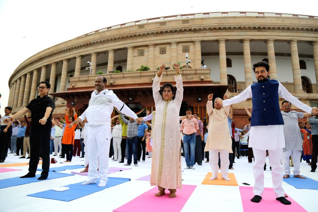 Lok Sabha Speaker Om Birla and Union Ministers Kiren Rijiju and Anurag Thakur participate in a Yoga session organised as part of 'Fit India' Movement, at Parliament premises in New Delhi ... - O, Kiren Rijiju and Anurag Thakur
