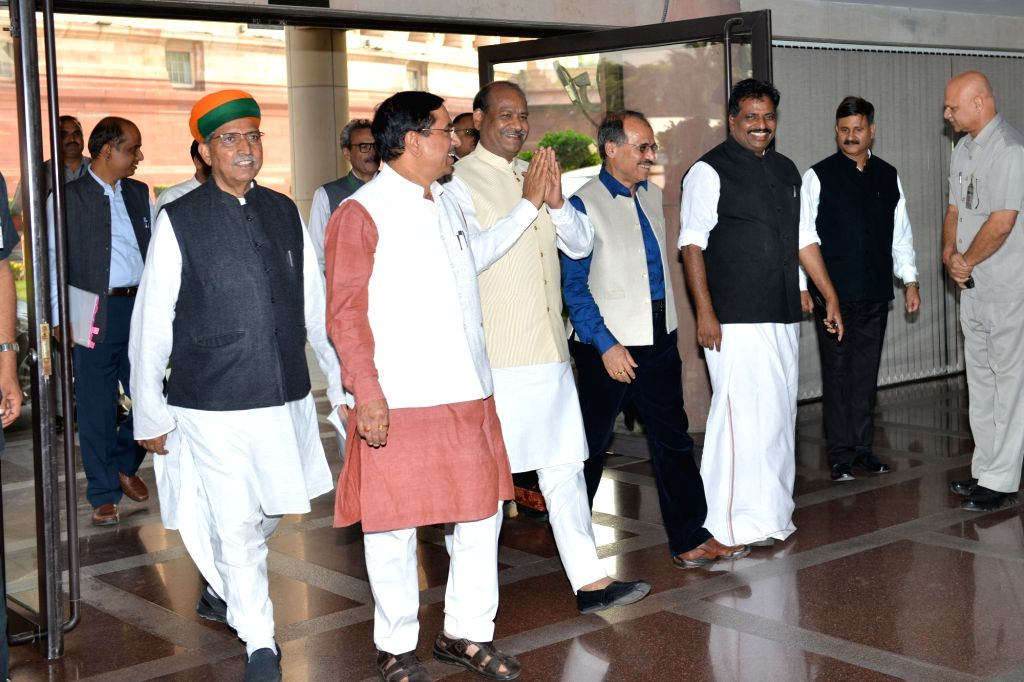 Lok Sabha Speaker Om Birla and Union Ministers Arjun Ram Meghwal and Pralhad Joshi arrive for an all-party meeting ahead of the Winter Session of Parliament, in New Delhi on Nov 16, 2019. - Pralhad Joshi and Arjun Ram Meghwal