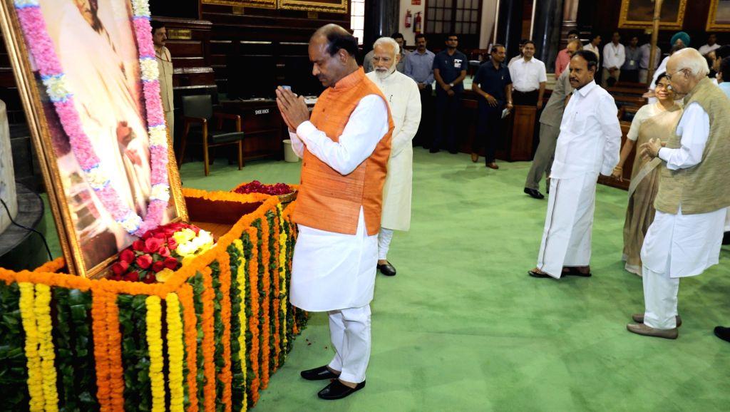 Lok Sabha Speaker Om Birla pays tribute to the portrait of Mahatma Gandhi on his 150th birth anniversary at the Parliament House, in New Delhi Oct 2, 2019 - O