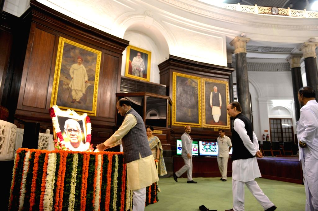 Lok Sabha Speaker Om Birla pays tributes to Former Lok Sabha Speaker Somnath Chatterjee on his birth anniversary, at Parliament House in New Delhi on July 25, 2019. - Somnath Chatterjee