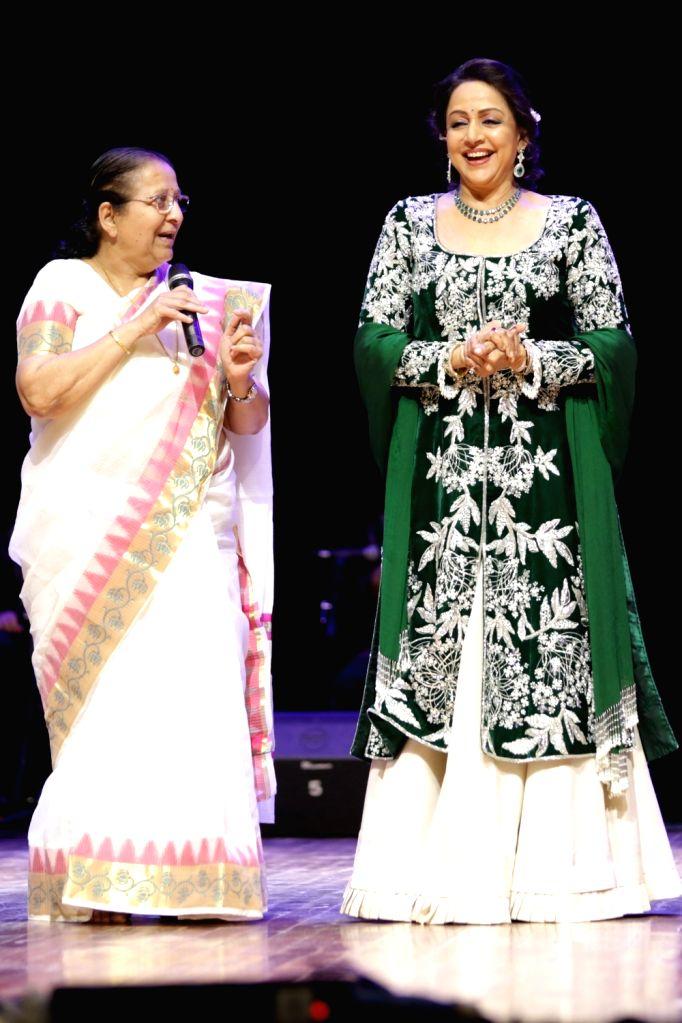 "Lok Sabha Speaker Sumitra Mahajan and actress and politician Hema Malini during ""SYNERGY 2017""  - an International Cultural Dance Festival in New Delhi on Sept 10, 2017. - Sumitra Mahajan and Hema Malini"