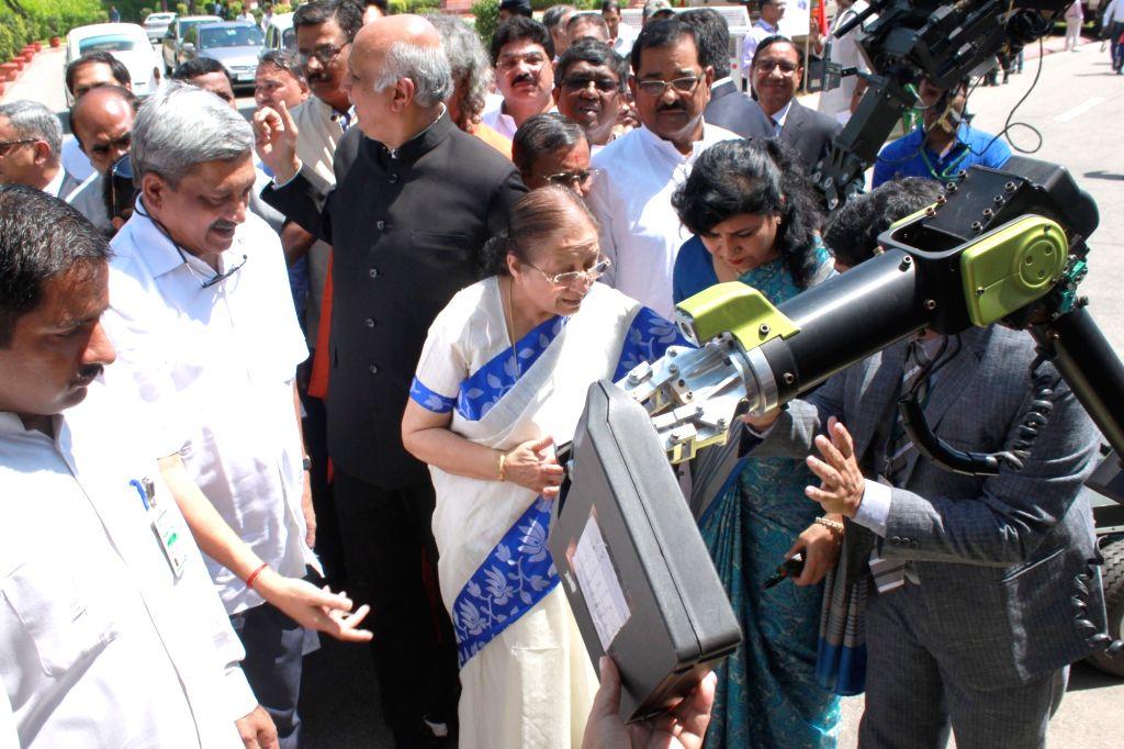 Lok Sabha Speaker Sumitra Mahajan and Union Defence Minister Manohar Parrikar inaugurate a DRDO exhibition at Parliament in New Delhi on Aug 3, 2016. - Sumitra Mahajan