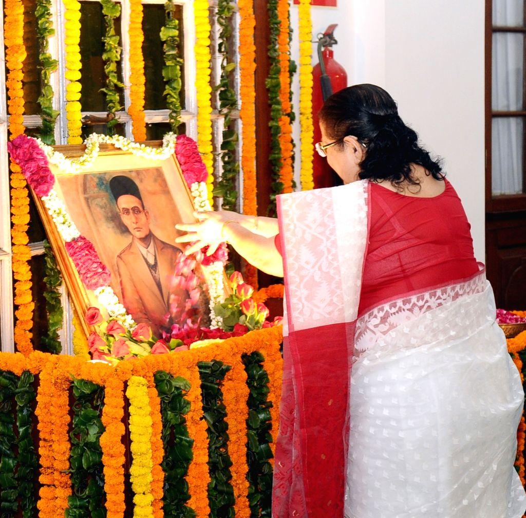Lok Sabha Speaker Sumitra Mahajan pays floral tributes at the portrait of Swatantryaveer Vinayak Damodar Savarkar, on his his birth anniversary, at Parliament House, in New Delhi on May ... - Sumitra Mahajan