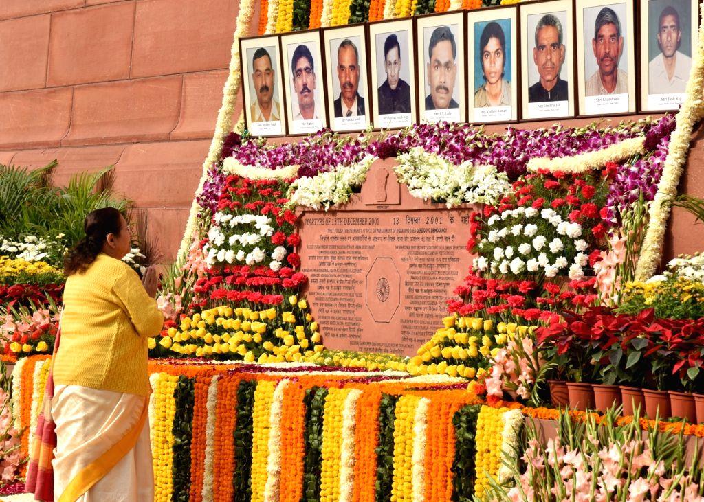 Lok Sabha Speaker Sumitra Mahajan pays tributes to the martyrs of the 2001 Parliament attack, in New Delhi, on Dec 13, 2018. - Sumitra Mahajan