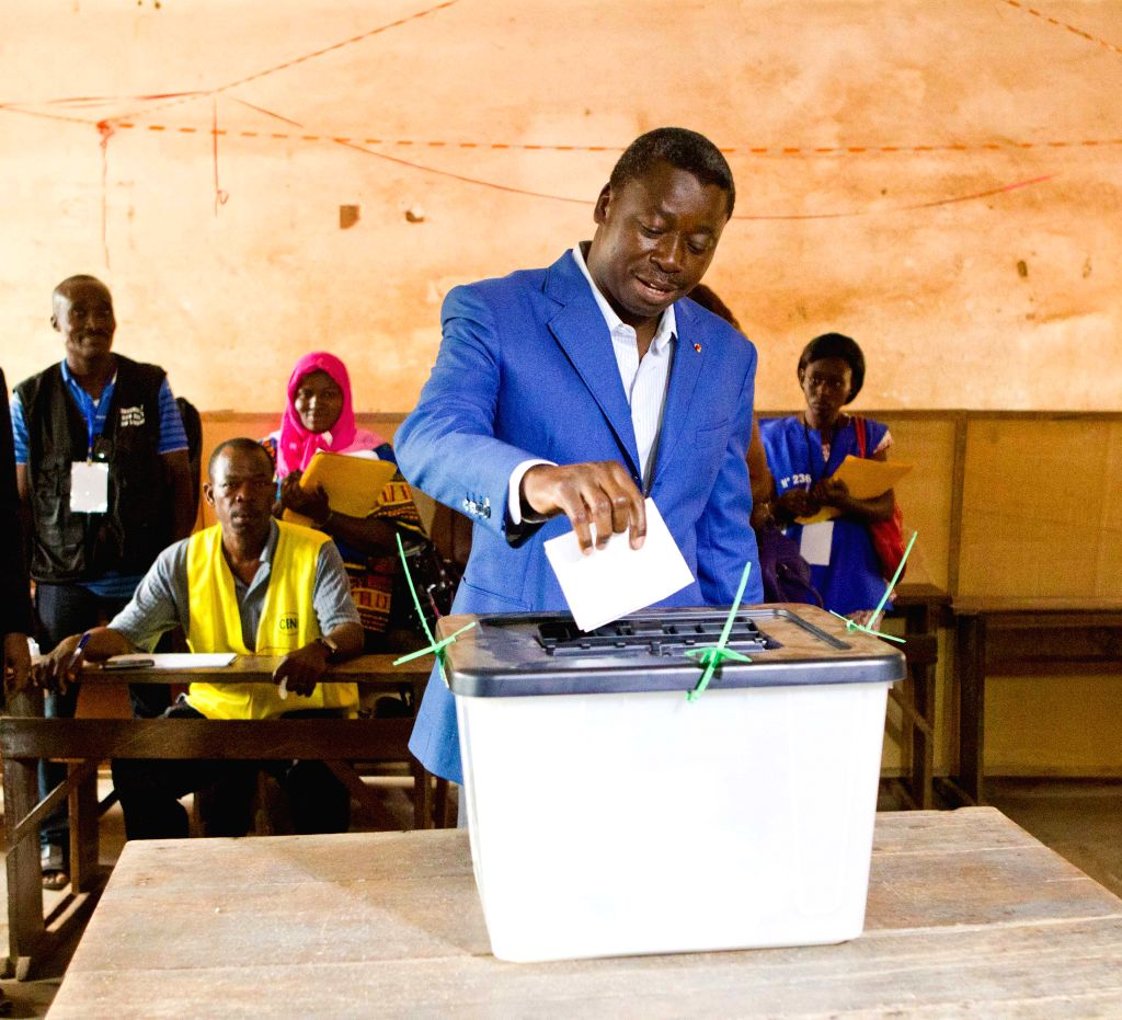 Togo's incumbent president Faure Gnassingbe casts his ballot at a polling station in Lome, Togo, April 25, 2015. Togo's voters began to cast their ballots on Saturday ...