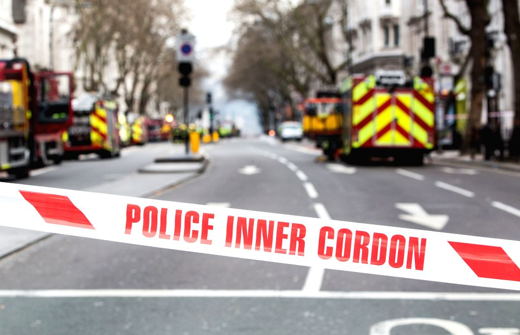 Policemen cordon off a street around the site of a fire in Central London's Holborn area, Britain, April 1, 2015. More than 2,000 people were evacuated Wednesday ...