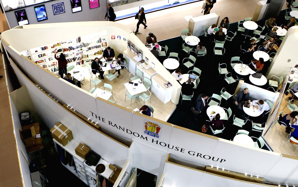 People attend the London Book Fair in London, Britain, April 10, 2014. The 43rd London Book Fair closed here Thursday. Photo: (Xinhua/Yin Gang)