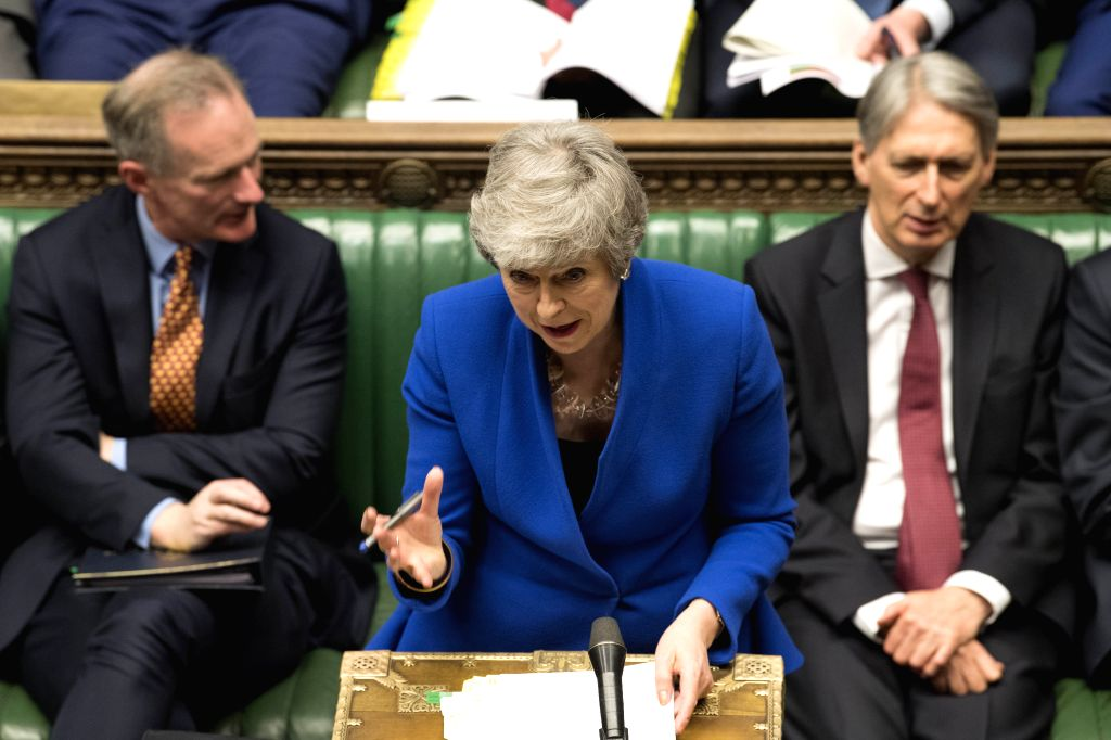 LONDON, April 10, 2019 (Xinhua) -- British Prime Minister Theresa May (C) attends the Prime Minister's Questions at the House of Commons in London, Britain, on April 10, 2019. Leaders of the European Union's remaining 27 member countries have agreed  - Theresa May