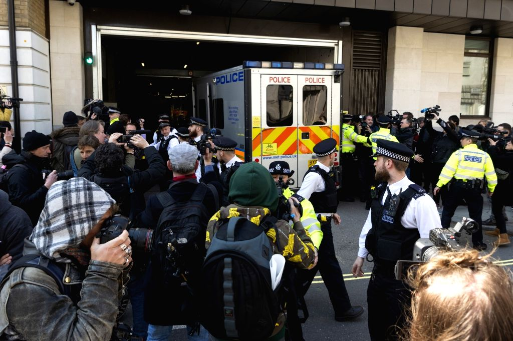 LONDON, April 11, 2019 - WikiLeaks founder Julian Assange in a police vehicle arrives at the Westminster magistrates court in London, Britain, on April 11, 2019. WikiLeaks founder Julian Assange has ...