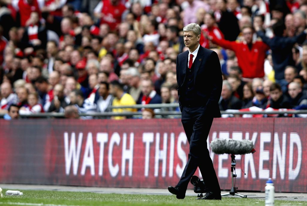 Arsene Wenger, manager of Arsenal, looks on during FA Cup semifinal match between Arsenal and Wigan Athletic at Wembley Stadium in London, Britain, on April 12, ...