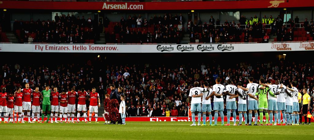 Arsenal and West Ham United players observe a minute's silence to mark the 25th anniversary of the Hillsborough disaster ahead of the Barclays Premier League match .