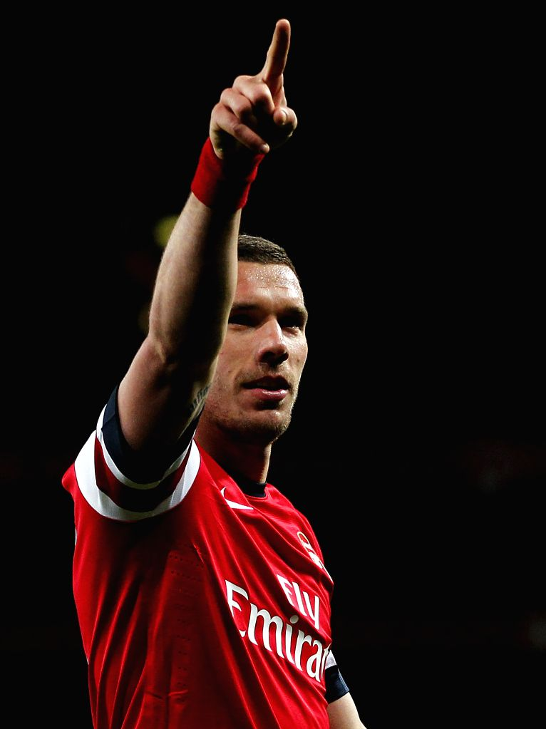 Lukas Podolski of Arsenal celebrates scoring his second goal during the Barclays Premier League match between Arsenal and West Ham United at Emirates Stadium in ...