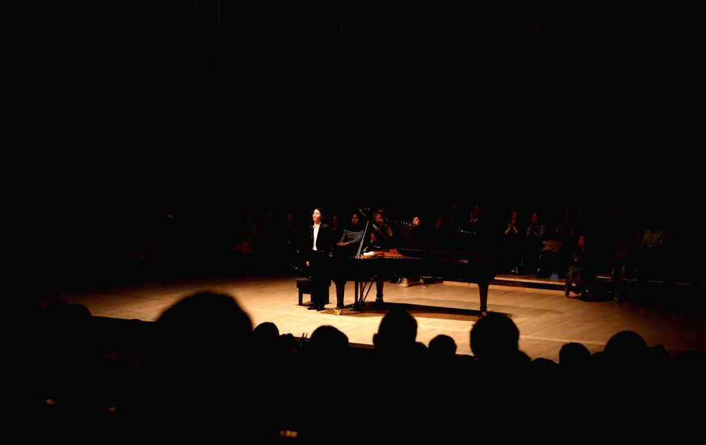 LONDON, April 20, 2016 - Pianist Li Yundi greets the spectators during his solo concert at the Royal Festival Hall in London, Britain, on April 19, 2016.