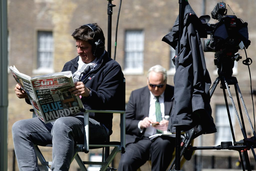 LONDON, April 20, 2017 - Media gather on College Green outside the houses of Parliament in London, Britain, on April 19, 2017. Members of Parliament in the British House of Commons gave their backing ... - Theresa M