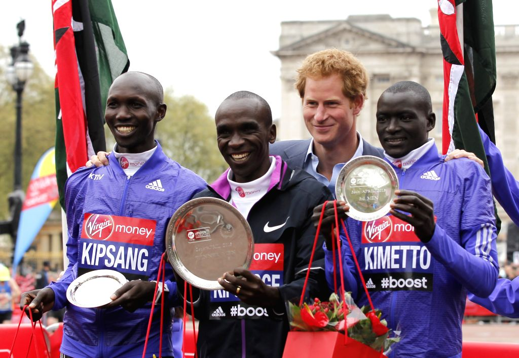 Britain's Prince Harry poses for a picture with winners of the Men's race Wilson Kipsang who came second(L), Eliud Kipchoge(C) who came first, and Dennis Kimetto(R) ...