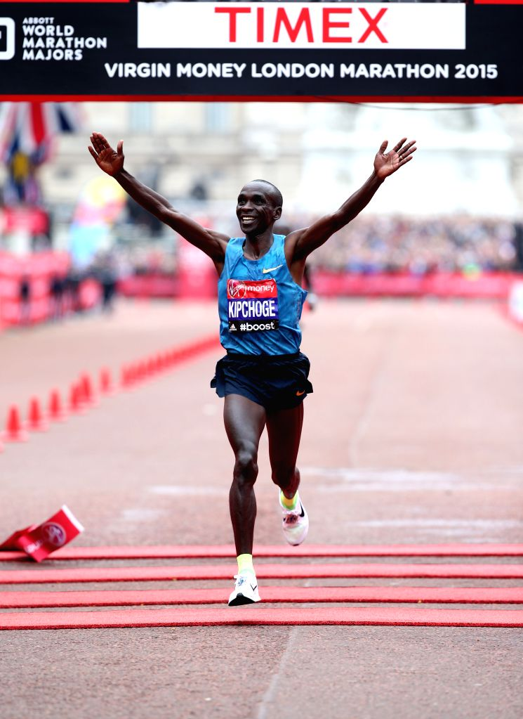 Eliud Kipchoge of Kenya crosses the finish line at the 35th London Marathon, Sunday, April 26, 2015. Eliud Kipchoge of Kenya won the men's race with 2 hours 4 ...