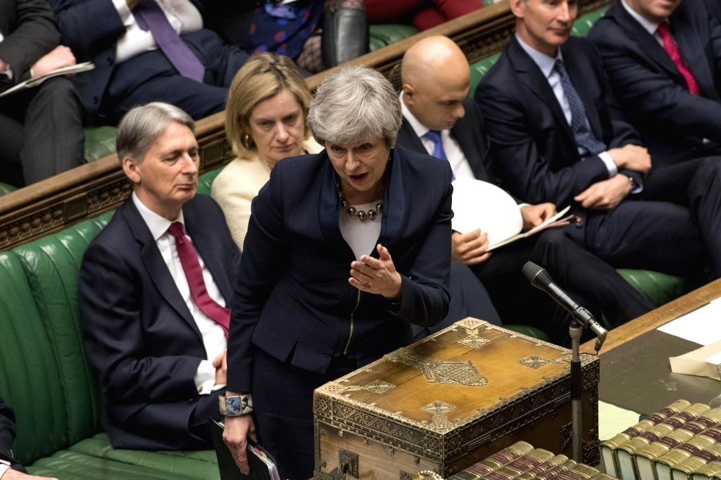 LONDON, April 4, 2019 (Xinhua) -- British Prime Minister Theresa May (front) attends the Prime Minister's Questions at the House of Commons in London April 3, 2019. British lawmakers on Wednesday night voted to support a bill that rules out no-deal a - Theresa May